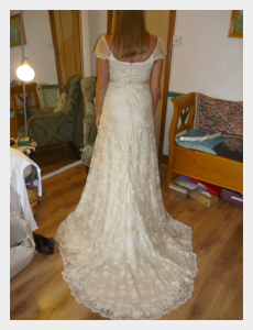 Wedding dress by Felicity Westmacott, Empire line wedding dress in pale gold silk satin and beaded lace: Fitting picture from the back