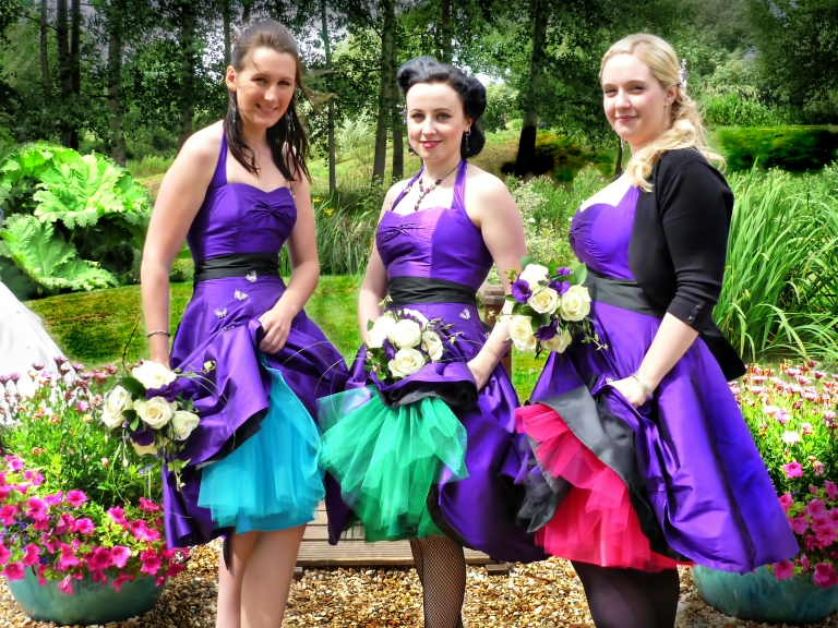 Cadbury Purple 1950's style bridesmaids dresses by Felicity Westmacott: with different colour net petticoats, blue, green and pink