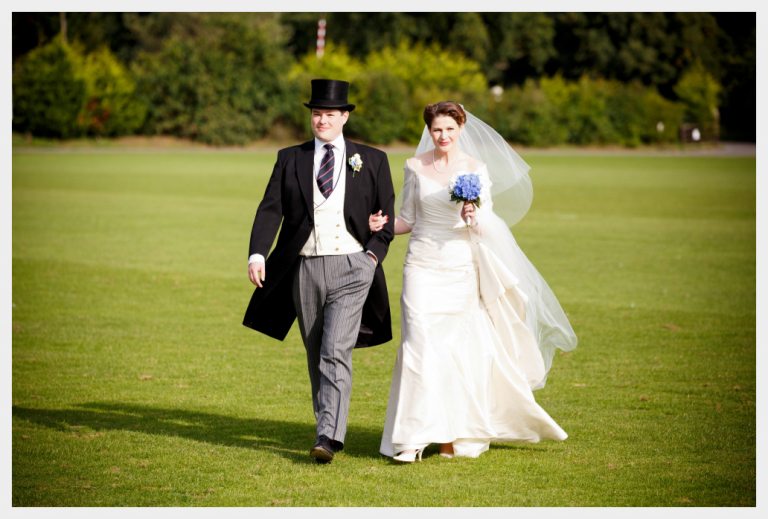 Wedding dress by Felicity Westmacott, Ivory silk dupion dress, walking across grass