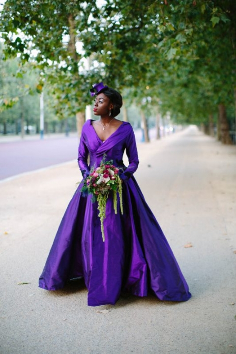 Design by Felicity Westmacott, Photography by Jessica Partridge, Burlesque inspired Purple silk wedding coat with statement collar and sweeping train: Model walks on The Mall, London