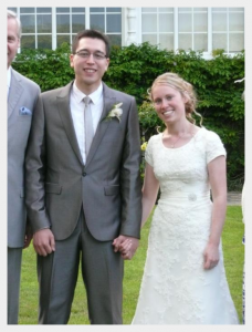 Wedding dress by Felicity Westmacott, Modest ivory lace and satin wedding dress: with the groom