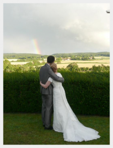 Wedding dress by Felicity Westmacott, Modest ivory lace and satin wedding dress: a rainbow blessing!
