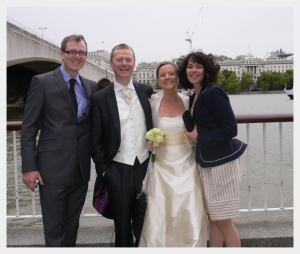 Wedding dress by Felicity Westmacott: cream silk with yellow sash and halter neck, wedding picture by the thames