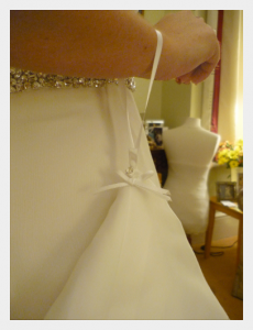 Wedding dress by Felicity Westmacott: White silk chiffon layers with diamante detail wrist loop detail