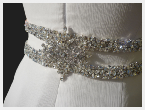 Wedding dress by Felicity Westmacott: White silk chiffon layers with diamante detail, the feature belt buckle was also made by hand