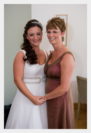 Dress and Bolero for Karen, Mother of the Bride, by Felicity Westmacott. Cerise chocolate silk, v-neck dress and waterfall collar bolero , with her duaghter the bride, also wearing a Felicity Westmacott creation.