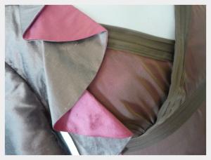 Dress and Bolero for Karen, Mother of the Bride, by Felicity Westmacott. Cerise chocolate silk, v-neck dress and waterfall collar bolero , neckline detail