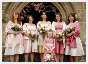 Bridesmaids dresses by Felicity Westmacott, pink ivory and gold silk dupion with sashes and off the shoulder straps