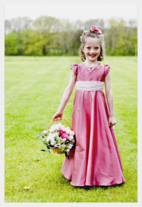 Flower girl dress by Felicity Westmacott in rose-pink silk dupion with organza sash and crystal applique