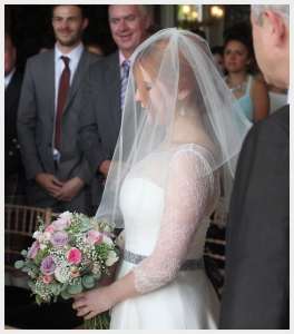 Wedding Dress by Felicity Westmacott: French lace and silk organza with ribbon sash, elbow length veil in ivory tulle