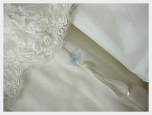 Wedding dress by Felicity Westmacott, vintage styling, satin and lace with beaded edging and silk sash a hidden something blue on the wristloop