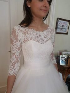 Ivory lace wedding dress by Felicity Westmacott with long sleeves and full tulle skirt: