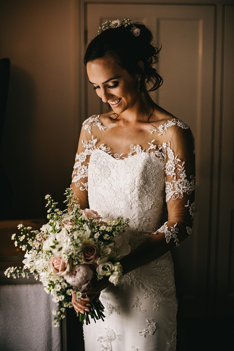 Portrait with bouquet Custom Wedding gown Boho floating lace sweetheart