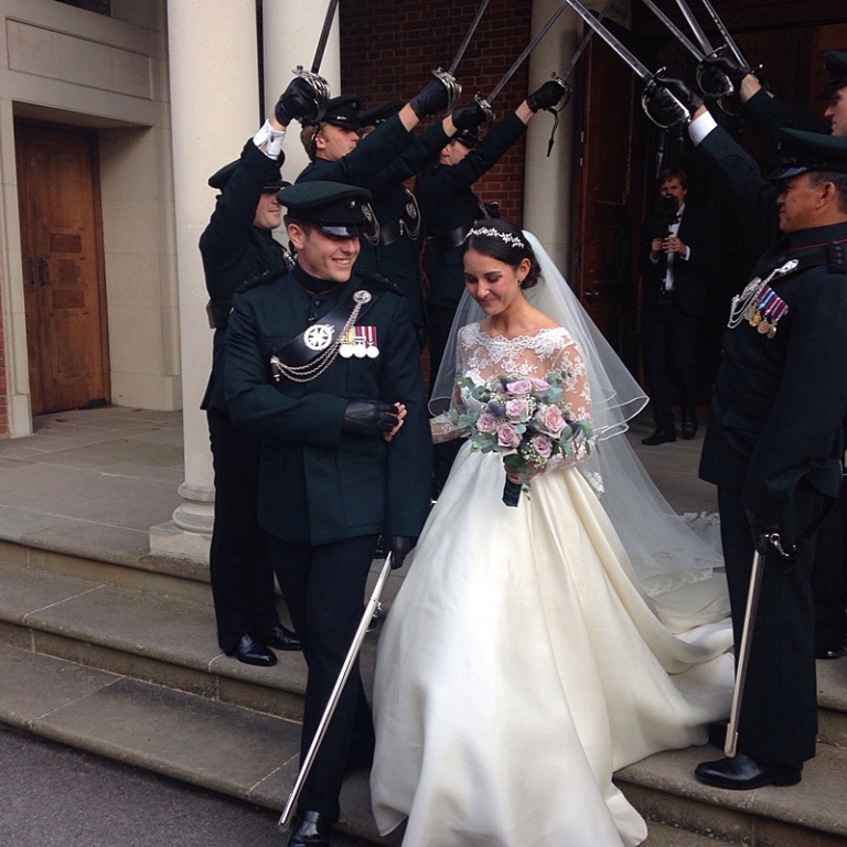 Traditional military wedding dress with full skirt and veil