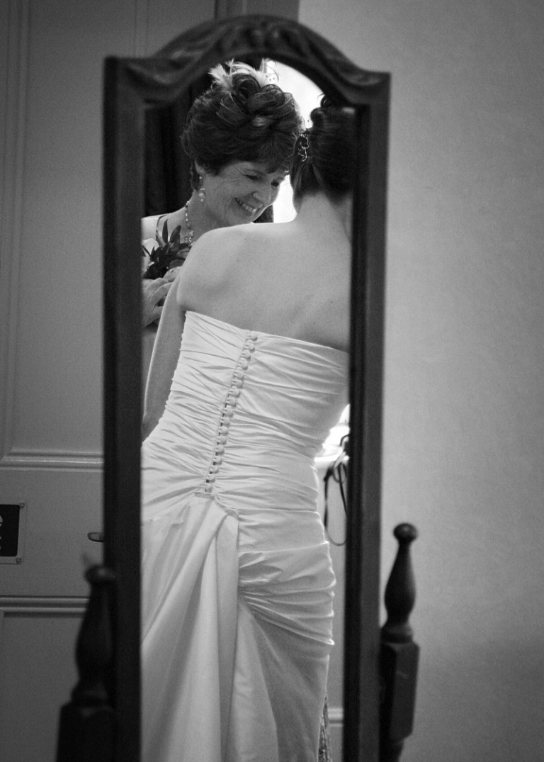 buttons and loops on wedding dress in mirror fastening alteration