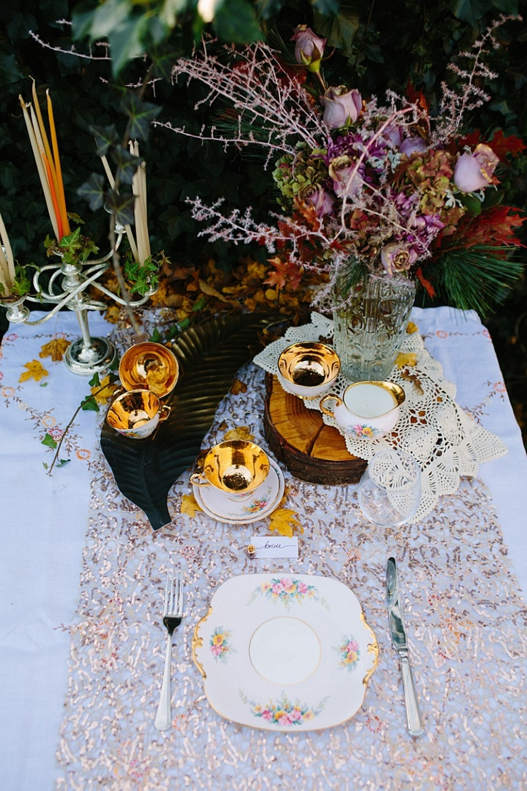 autumn photoshoot table setting inspo gold flowers and candles