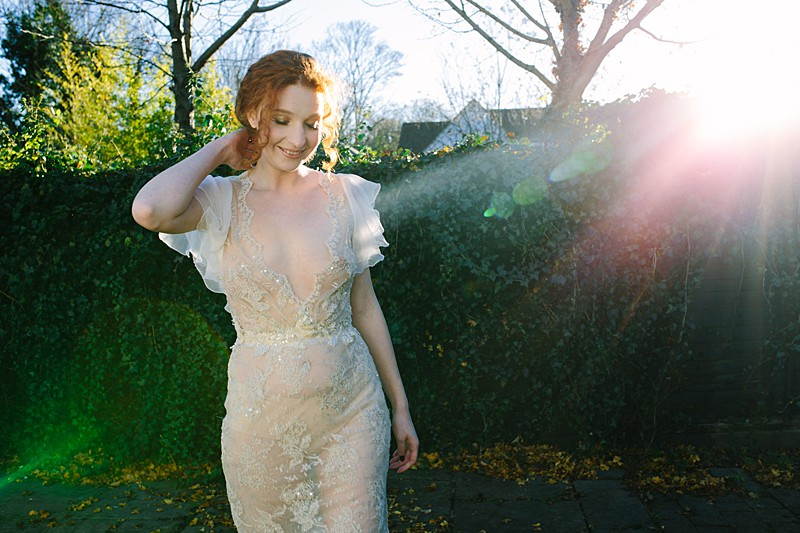 winter sun on shear metallic wedding gown silver beaded slim