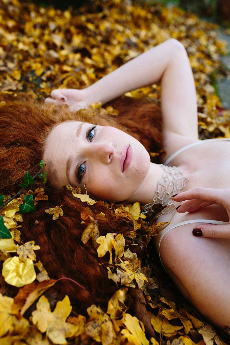 styled shoot with gold leaves red hair bridal inspiration