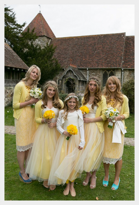 outside the church daffodil bouquets and spring bridesmaids yellow dresses bridal party attendants