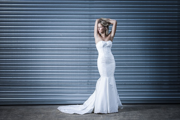 wedding dress with petal train and lace hem sweetheart neckline fishtail