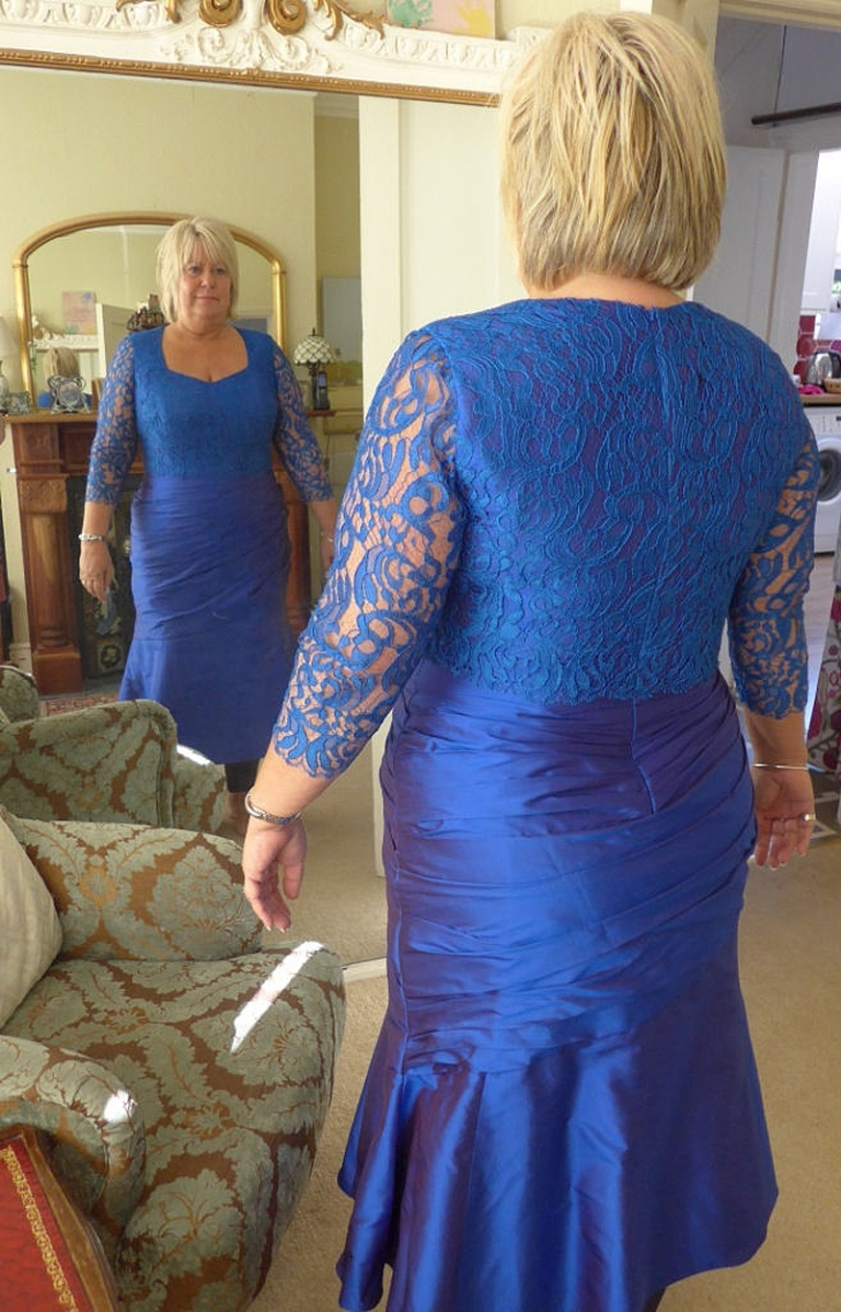 final fitting picture in the mirror blue silk dupion and lace fit and flare dress with ruching mother of the bride
