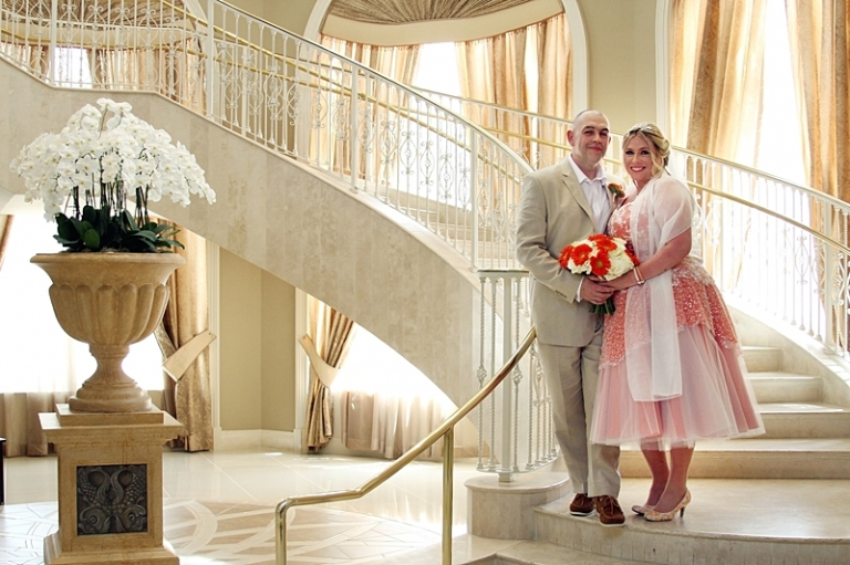 three quarter length wedding dress over petticoat on staircase coloured