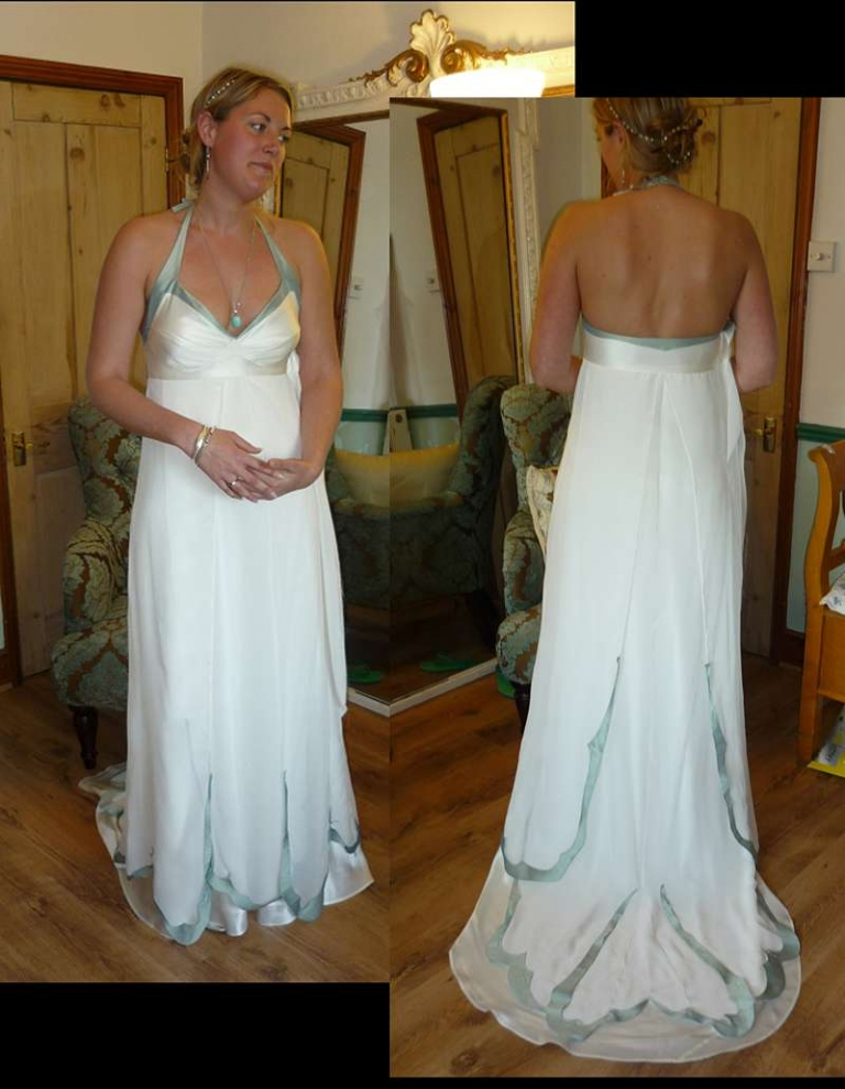 fitting picture bespoke wedding dress with blue trim