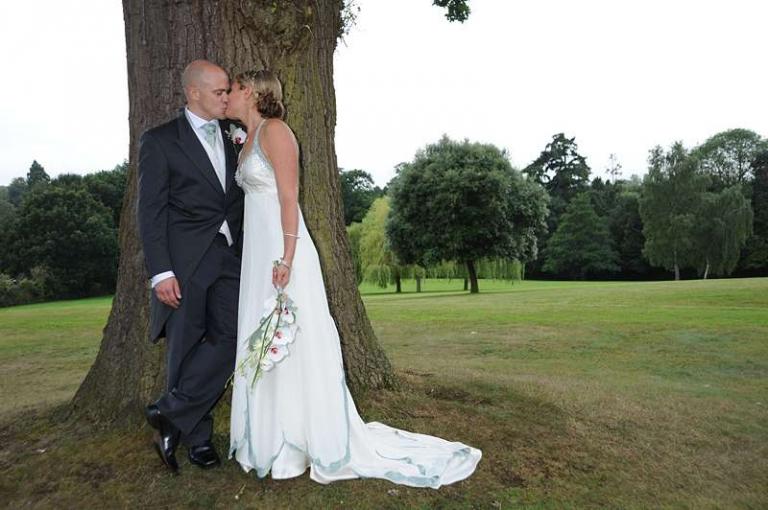 couture wedding dress with aqua blue silk trim and edging
