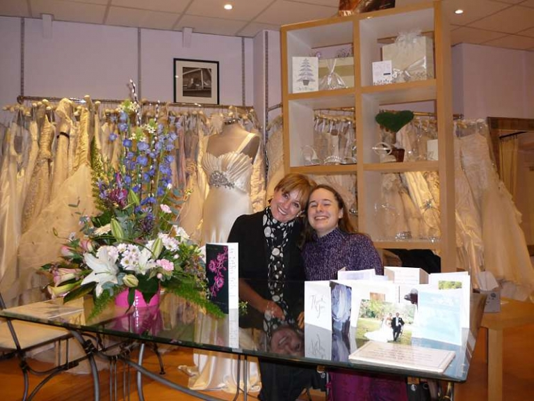Me and my boss in the wedding dress shop flowers and dress rail
