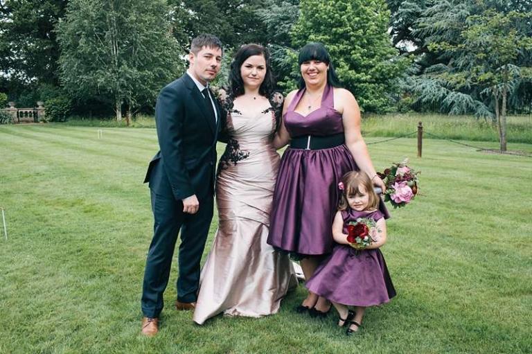 gothic bride with purple plum bridesmaids