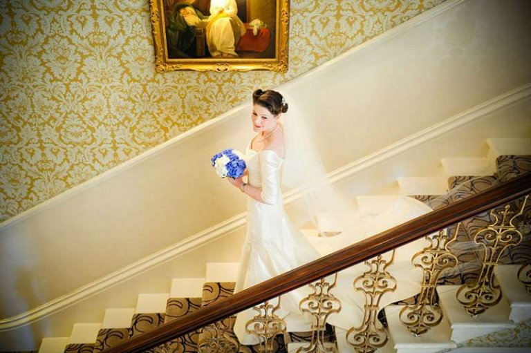 bride on the staircase traditional ivory silk dress