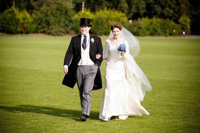 top hat and morning coat groom ivory silk wedding dress english summer
