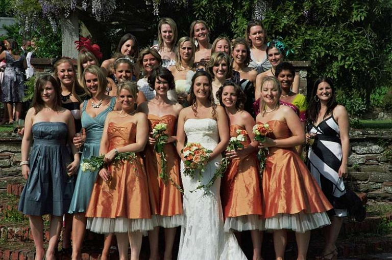 all the girls orange silk bridesmaids dresses in the sun