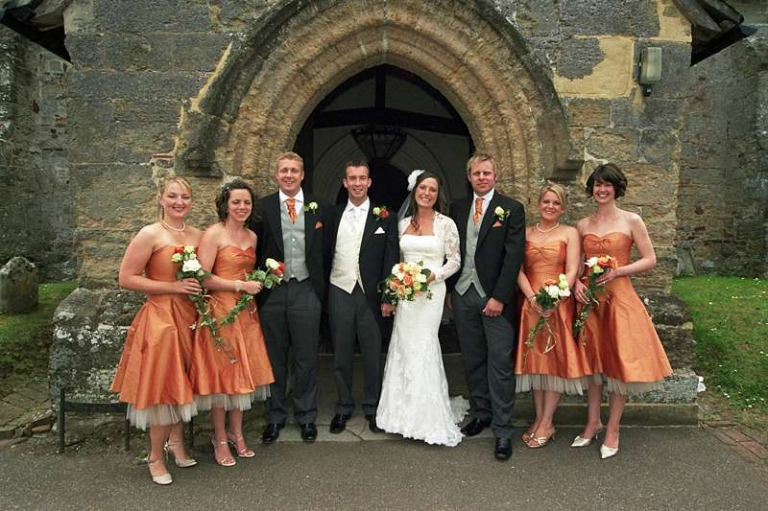wedding party in orange silk and ivory