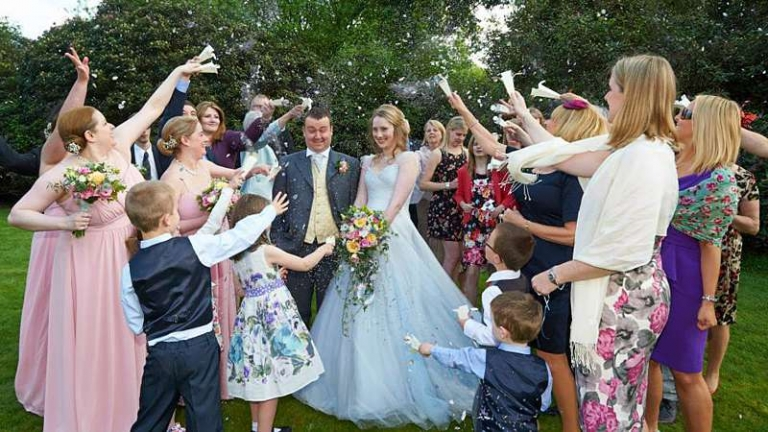 confetti shot just married blue wedding dress